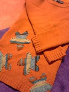 oranssi-villapaita-applikoidut-kukat